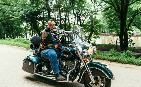 Image of Cameron Leehey, Biker Lawyer, on Meet the Crew Page, Riding his Motorcycle