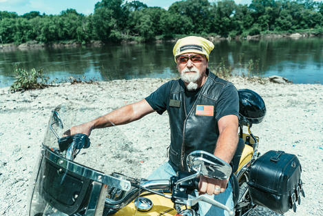 Image of Dan Matzdorff, Biker Lawyer, on Meet the Crew page, sitting on Motorcycle.