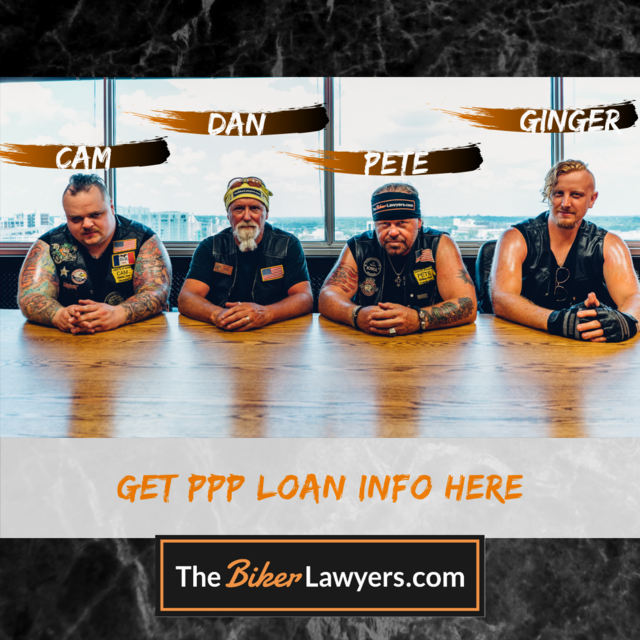The Biker Lawyers sitting at table discussing PPP Loans as the best motorcycle attorneys